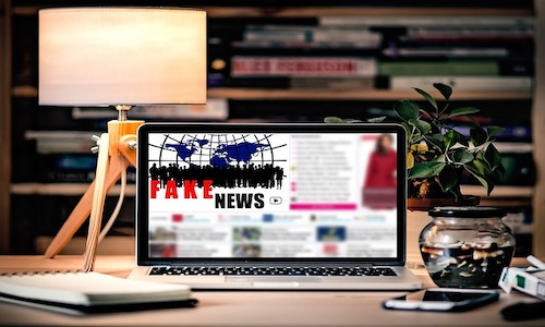 """A laptop screen showing the words """"Fake News."""""""